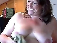 Chubby mature shows her body in kitchen
