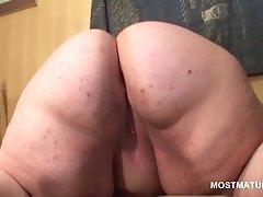 Slutty bbw mature sucks and tit fucks large dildo