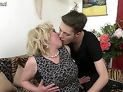 Horny big breasted mom fucking and sucking her toy boy