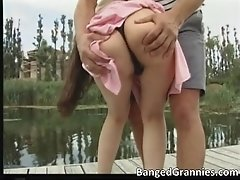 Nasty brunette babewith great tits blows stiff rod outd
