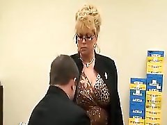 Tall Mature Lady In Office With Her Foot Slave
