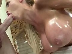 Big Tits Oiled MILF Gives A Good Blowjob