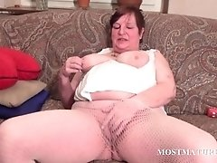 Chesty mature satisfies cunt with vibrator