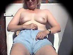 Mature masturbates on balcony