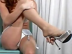 Hot milf strips and masturbates