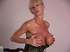 Mature lady with big silicone tits masturbating