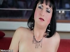 See How Horny This Dark Haired MILF With Big Boobs Gets