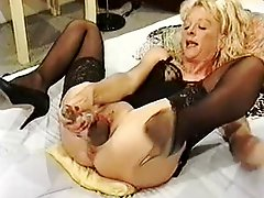 Mature woman opening her pussy with big objects
