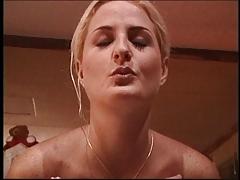 Blonde hottie maturbates & gives a handjob