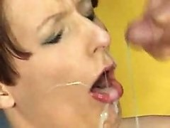 Shorthaired beautyfull mature taking facials