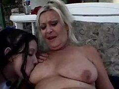 Old Lady With A Sexy Young Brunette Outside On Patio