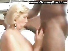 Granny Enjoys Two Big Black Cock