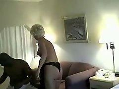 Mature blonde fucks black