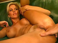 Blond with fake boobs gets her ass drilled and fingered after giving head