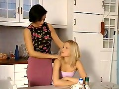Sexy MILF Caring For Younger Girl