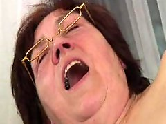 Hairy granny in Glasses Dildos Spreads Sucks and Fucks