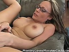 Horny Momma Is Fucking A Big Black Cock On The Sofa