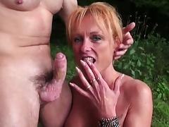 Redhead milf having sex in the woods