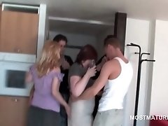 Mature tramps sucking teen shaft in group sex