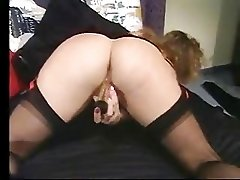 Big titted MILF pleases herself