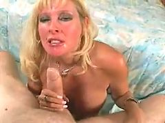 Big Titted Mature Gets A Mouthful